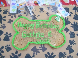 Guthrie and Jake's B-day cake. You can see the cute paw-print crepe-paper I used to tie the party favors in the background