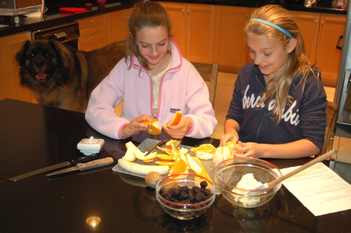 Emma and Abby get going on their fruit pizza.