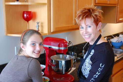 Emma and Karen contemplate cupcake-making in Baking School.